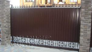 Кованые откатные ворота фото